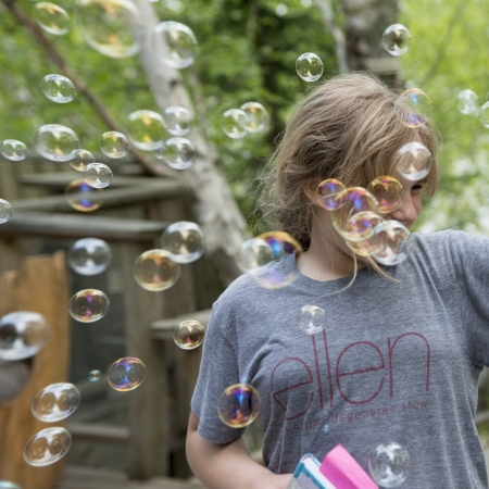 Close-up of a woman smiling while surrounded by bubbles, Lake of The Woods, Keewatin, Ontario, Canada