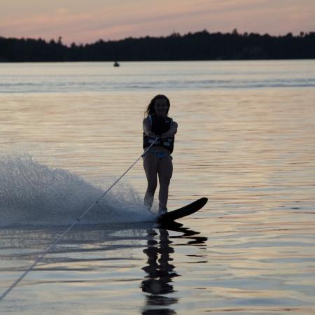 Girl waterskiing in a lake, Lake of The Woods, Keewatin, Ontario, Canada