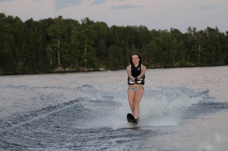 wakeboarding: Girl waterskiing in a lake, Lake of The Woods, Keewatin, Ontario, Canada Stock Photo