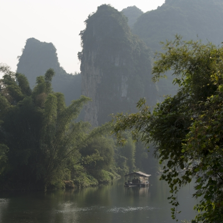 Wooden raft in the Yulong River, Yangshuo, Guilin, Guangxi Province, China