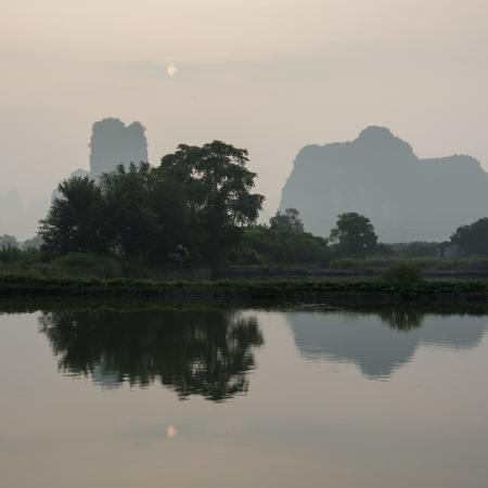placidness: Reflection of trees on Yulong River, Yangshuo, Guilin, Guangxi Province, China