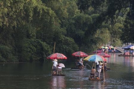 Tourists on bamboo rafts, Yulong River, Yangshuo, Guilin, Guangxi Province, China