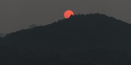Sunset over mountain, Yangshuo, Guilin, Guangxi Province, China