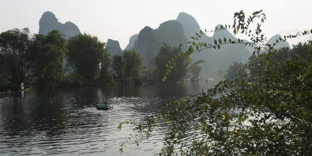 placidness: View of Yulong River with mountains in the background, Yangshuo, Guilin, Guangxi Province, China
