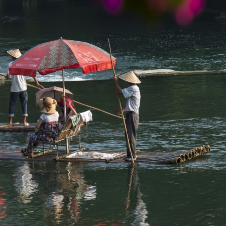 vacationer: Tourists on a bamboo raft in Yulong River, Yangshuo, Guilin, Guangxi Province, China