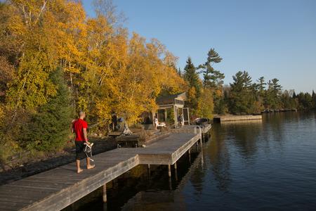 Man walking on a boardwalk, Kenora, Lake of The Woods, Ontario, Canada