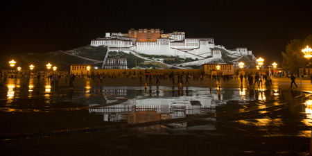 potala: Potala Palace at night, Potala Palace Square, Lhasa, Tibet, China Editorial