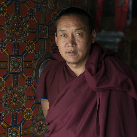 waistup: Buddhist monk in Drepung Monastery, Lhasa, Tibet, China