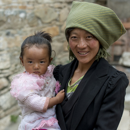 eyecontact: Portrait of a woman with her daughter in Drepung Monastery, Lhasa, Tibet, China