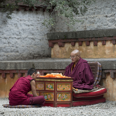 buddhist monk: Buddhist monk reciting teachings of Buddha to his pupil in Sera Monastery, Lhasa, Tibet, China