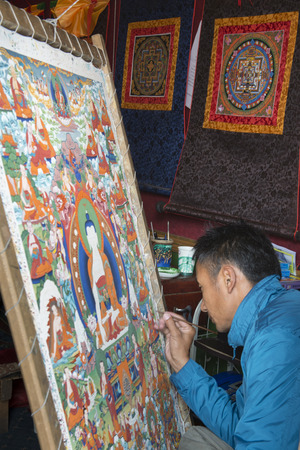 Tibetan painter making a painting of Buddha, Barkhor, Lhasa, Tibet, China
