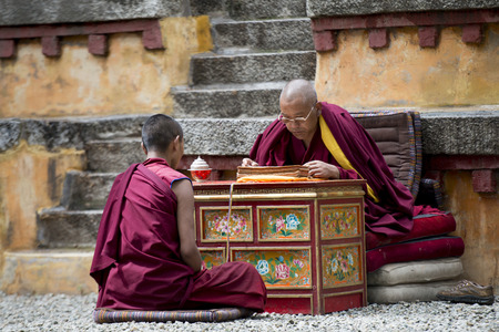 Buddhist monk reciting teachings of Buddha to his pupil in Sera Monastery, Lhasa, Tibet, China