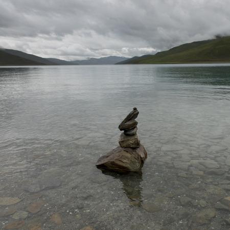Stack of stones in the Yamdrok Lake, Nagarze, Shannan, Tibet, China photo