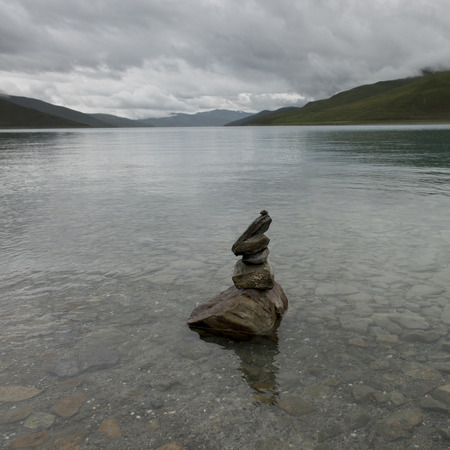 placidness: Stack of stones in the Yamdrok Lake, Nagarze, Shannan, Tibet, China