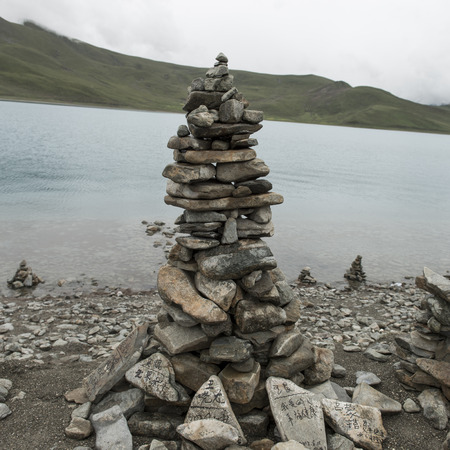 tranquilly: Stack of stones at the lakeside, Yamdrok Lake, Nagarze, Shannan, Tibet, China Stock Photo