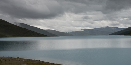 placidness: Yamdrok Lake with mountains under cloudy sky, Nagarze, Shannan, Tibet, China