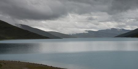 Yamdrok Lake with mountains under cloudy sky, Nagarze, Shannan, Tibet, China Stock Photo - 26509948