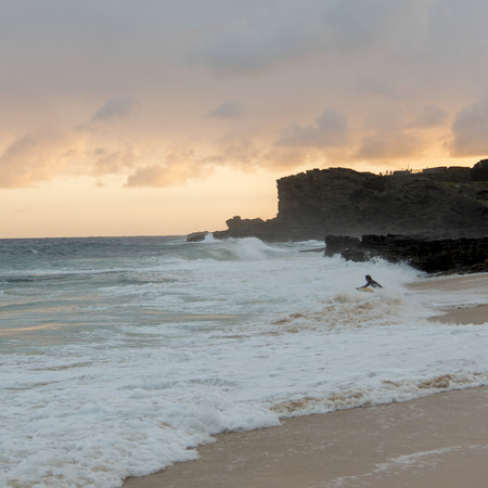 Tourist surfing on the beach, Sandy Beach, Hawaii Kai, Honolulu, Oahu, Hawaii, USA photo