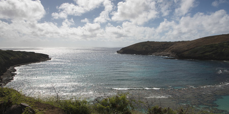Clouds over the Hanauma Bay, Hawaii Kai, Honolulu, Oahu, Hawaii, USA photo