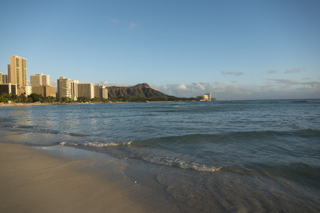honolulu: Waves on the beach with buildings in the background, Waikiki, Honolulu, Oahu, Hawaii, USA