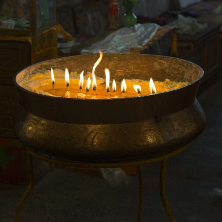 molted: Burning candles in Drepung Monastery, Lhasa, Tibet, China Stock Photo