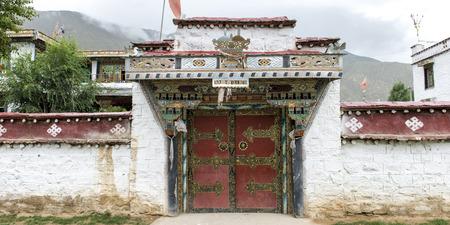 tibetan house: Facade of traditionally Tibetan building in a village, Tibet, China Stock Photo