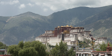 potala: View of the Potala Palace with mountains in the background, Lhasa, Tibet, China