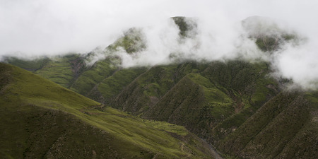 placidness: High angle view of foggy mountains, Gonggar, Shannan, Tibet, China Stock Photo