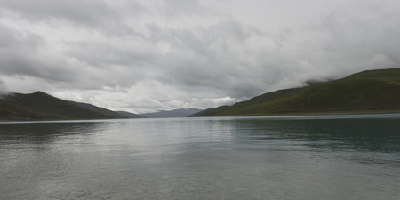 tranquilly: Yamdrok Lake with mountains under cloudy sky, Nagarze, Shannan, Tibet, China