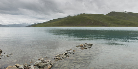 placidness: Yamdrok Lake with mountains in the background, Nagarze, Shannan, Tibet, China