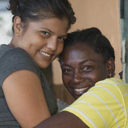 cay: Portrait of female friends smiling, Cayman Cay, Utila Island, Bay Islands, Honduras