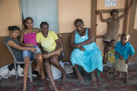 cayman: Family at their home, Cayman Cay, Utila Island, Bay Islands, Honduras