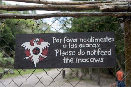 chainlink: Do not feed macaw sign on a fence, Copan, Copan Ruinas, Copan Department, Honduras Stock Photo