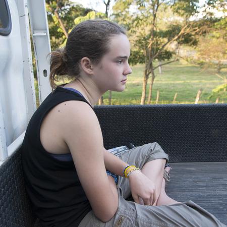 Closeup of a teenage girl sitting, Copan, Copan Ruinas, Honduras
