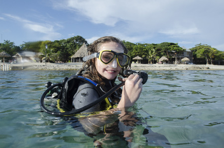 Female scuba diver in the sea, Utila, Bay Islands, Honduras Editorial