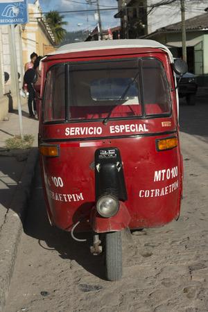 incidental people: Auto rickshaw on a street, Barrio El Centro, Copan, Copan Ruinas, Honduras