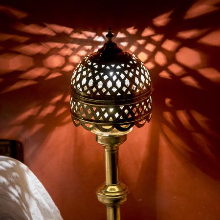 sultana: Traditional lamp illuminated in a room at La Sultana Hotel, Marrakesh, Morocco