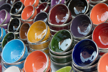 souk: Close-up of colorful bowls for sale at market stall, Medina, Marrakesh, Morocco Stock Photo