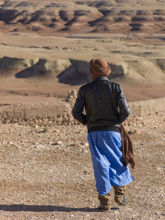 Tuareg man looking at a town view from the terrace of a fort, Ait Benhaddou, Ouarzazate, Souss-Massa-Draa, Morocco Stock Photo
