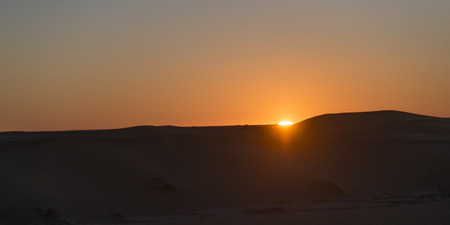 erg: Sunset over Erg Chegaga Dunes in Sahara Desert, Morocco Stock Photo