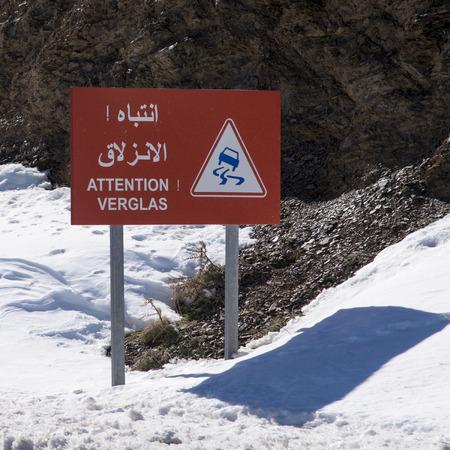 Signboard on snowy valley in winter, Tizi nTichka, Atlas Mountains, Morocco