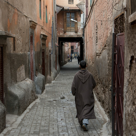 incidental people: Man walking in a narrow street, Medina, Marrakesh, Morocco