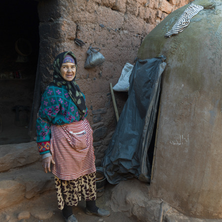 Woman standing outside her house, Morocco