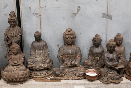 Buddha statues in Panjiayuan antique market, Beijing, China photo