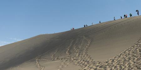 Tourists at Mingsha Shan, Dunhuang, Jiuquan, Gansu Province, China