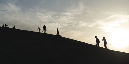 Tourists at Mingsha Shan, Dunhuang, Jiuquan, Gansu Province, China photo