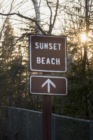 Sign board of Sunset Beach, Hecla Grindstone Provincial Park, Manitoba, Canada photo