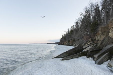 lake winnipeg: Snow at the lakeside, Lake Winnipeg, Hecla Grindstone Provincial Park, Manitoba, Canada Stock Photo