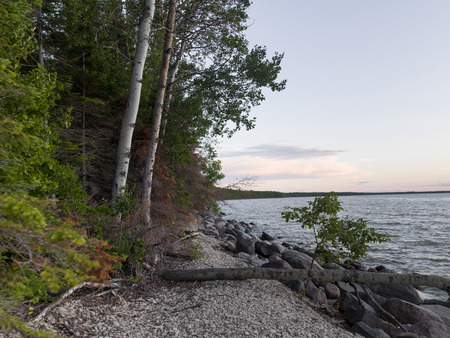 lake winnipeg: Trees and rocks along shoreline, Lake Winnipeg, Riverton, Hecla Grindstone Provincial Park, Manitoba, Canada