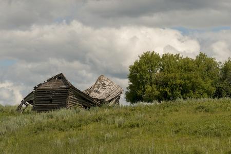 abandoned farmhouse abandoned farmhouse: Abandoned farmhouse in a field, Riding Mountain National Park, Manitoba, Canada